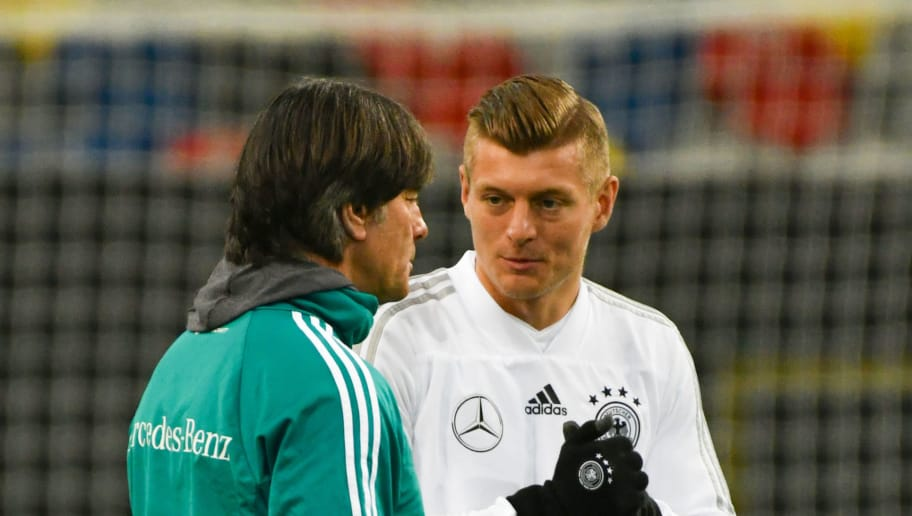Germany's headcoach Joachim Loew talks to Germany's midfielder Mesut Ozil (R) and Germany's midfielder Toni Kroos (C) during a training session of the German team ahead of their international friendly match against Spain at Paul-Janes-Stadion on March 22, 2018 in Duesseldorf, western Germany.  / AFP PHOTO / Patrik STOLLARZ        (Photo credit should read PATRIK STOLLARZ/AFP/Getty Images)