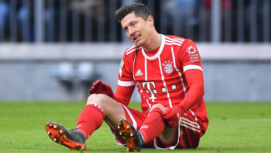 MUNICH, GERMANY - FEBRUARY 24: Robert Lewandowski of Bayern Muenchen sits on the pitch during the Bundesliga match between FC Bayern Muenchen and Hertha BSC at Allianz Arena on February 24, 2018 in Munich, Germany. (Photo by Sebastian Widmann/Bongarts/Getty Images)