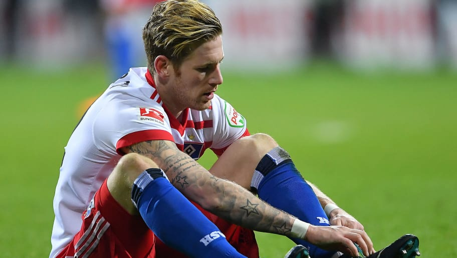 BREMEN, GERMANY - FEBRUARY 24: Andre Hahn of Hamburg sits on the pitch dejected after the Bundesliga match between SV Werder Bremen and Hamburger SV at Weserstadion on February 24, 2018 in Bremen, Germany. (Photo by Stuart Franklin/Bongarts/Getty Images)