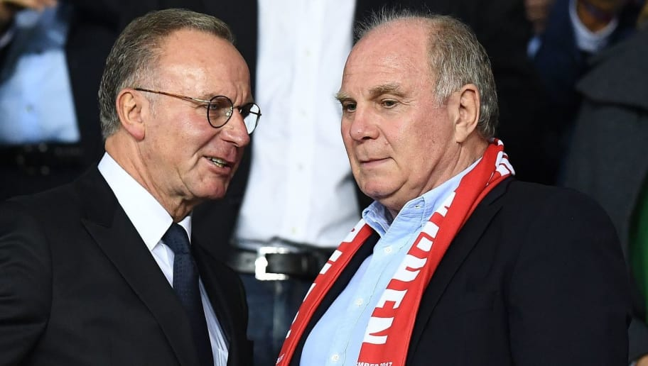 Bayern Munich president Uli Hoeness (R) speaks with CEO of Bayern Munich, Karl-Heinz Rummenigge before the UEFA Champions League football match between Paris Saint-Germain and Bayern Munich on September 27, 2017 at the Parc des Princes stadium in Paris.   / AFP PHOTO / FRANCK FIFE        (Photo credit should read FRANCK FIFE/AFP/Getty Images)