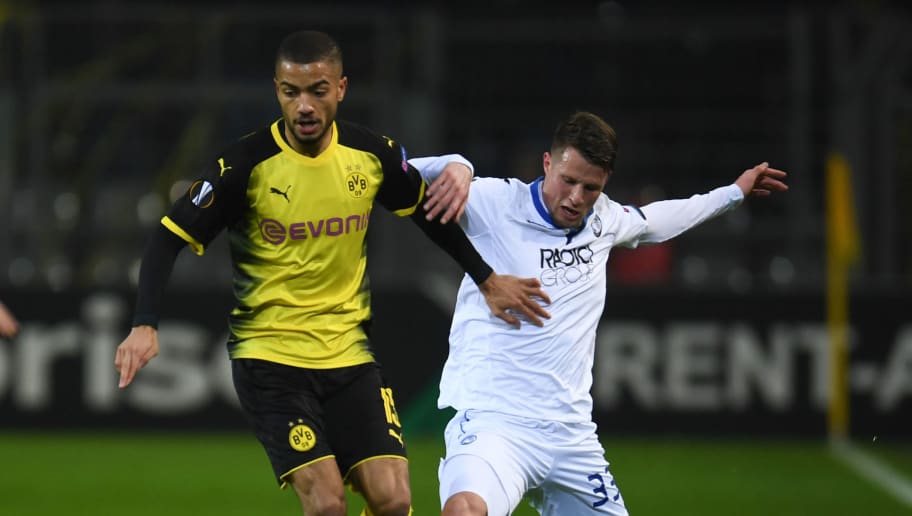 Dortmund's German defender Jeremy Toljan (L) and Bergamo's Hans Hateboer vie for the ball during the UEFA Europa League round of 32, first leg football match of Germany's Borussia Dortmund vs Italy's Atalanta Bergamo on February 15, 2018 in Dortmund, western Germany. / AFP PHOTO / Patrik STOLLARZ        (Photo credit should read PATRIK STOLLARZ/AFP/Getty Images)