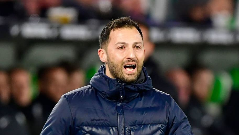 Schalke's German headcoach Domenico Tedesco reacts during the German First division Bundesliga football match VfL Wolfsburg vs Schalke 04, in Wolfsburg, on March 17, 2018. / AFP PHOTO / John MACDOUGALL / RESTRICTIONS: DURING MATCH TIME: DFL RULES TO LIMIT THE ONLINE USAGE TO 15 PICTURES PER MATCH AND FORBID IMAGE SEQUENCES TO SIMULATE VIDEO. == RESTRICTED TO EDITORIAL USE == FOR FURTHER QUERIES PLEASE CONTACT DFL DIRECTLY AT + 49 69 650050  / RESTRICTIONS: DURING MATCH TIME: DFL RULES TO LIMIT THE ONLINE USAGE TO 15 PICTURES PER MATCH AND FORBID IMAGE SEQUENCES TO SIMULATE VIDEO. == RESTRICTED TO EDITORIAL USE == FOR FURTHER QUERIES PLEASE CONTACT DFL DIRECTLY AT + 49 69 650050        (Photo credit should read JOHN MACDOUGALL/AFP/Getty Images)