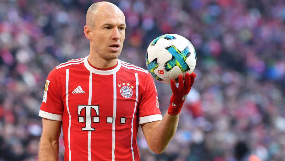 MUNICH, GERMANY - FEBRUARY 24: Arjen Robben of Bayern Muenchen holds the ball in his hand during the Bundesliga match between FC Bayern Muenchen and Hertha BSC at Allianz Arena on February 24, 2018 in Munich, Germany. (Photo by Sebastian Widmann/Bongarts/Getty Images)