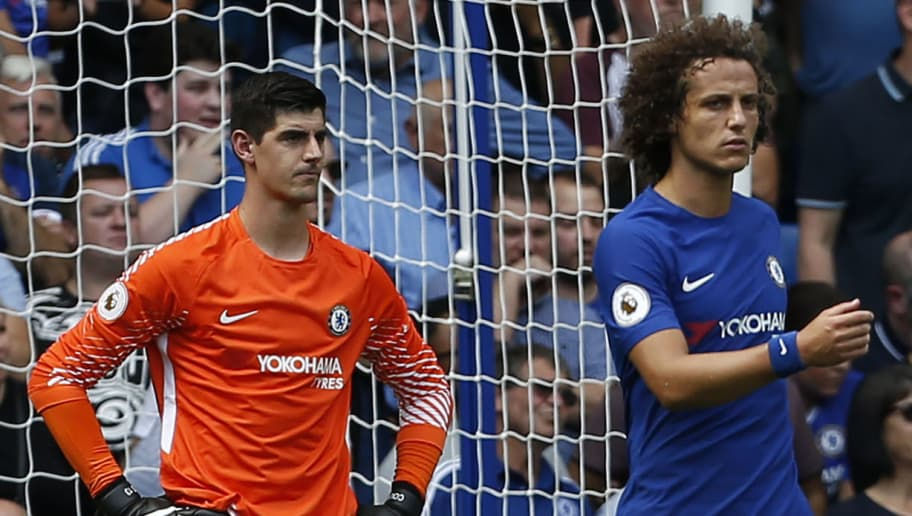Chelsea's Belgian goalkeeper Thibaut Courtois (L) and Chelsea's Brazilian defender David Luiz react after conceding their second goal during the English Premier League football match between Chelsea and Burnley at Stamford Bridge in London on August 12, 2017. / AFP PHOTO / Ian KINGTON / RESTRICTED TO EDITORIAL USE. No use with unauthorized audio, video, data, fixture lists, club/league logos or 'live' services. Online in-match use limited to 75 images, no video emulation. No use in betting, games or single club/league/player publications.  /         (Photo credit should read IAN KINGTON/AFP/Getty Images)