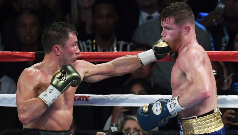 LAS VEGAS, NV - SEPTEMBER 16:  Gennady Golovkin (L) throws a left at Canelo Alvarez in the 12th round of their WBC, WBA and IBF middleweight championship bout at T-Mobile Arena on September 16, 2017 in Las Vegas, Nevada. The boxers fought to a draw and Golovkin retained his titles.  (Photo by Ethan Miller/Getty Images)