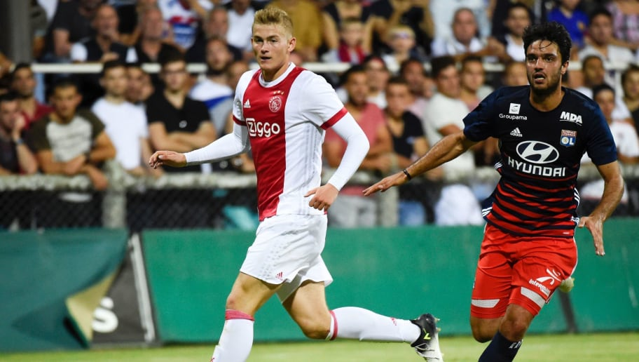 Ajax defender Matthijs de Ligt (L) vies with Lyon's French midfielder Clement Grenier during a friendly football match between Olympique Lyonnais and Ajax Amsterdam on July 18, 2017 at the Pierre Rajon stadium in Bourgoin-Jallieu.  / AFP PHOTO / JEAN-PHILIPPE KSIAZEK        (Photo credit should read JEAN-PHILIPPE KSIAZEK/AFP/Getty Images)
