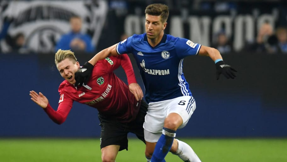 Schalke's defender Matija Nastasic and Hanover's striker Felix Klaus vie for the ball during the German First division Bundesliga football match FC Schalke 04 vs Hanover 96 in Gelsenkirchen, western Germany, on January 21, 2018. / AFP PHOTO / PATRIK STOLLARZ / RESTRICTIONS: DURING MATCH TIME: DFL RULES TO LIMIT THE ONLINE USAGE TO 15 PICTURES PER MATCH AND FORBID IMAGE SEQUENCES TO SIMULATE VIDEO. == RESTRICTED TO EDITORIAL USE == FOR FURTHER QUERIES PLEASE CONTACT DFL DIRECTLY AT + 49 69 650050         (Photo credit should read PATRIK STOLLARZ/AFP/Getty Images)