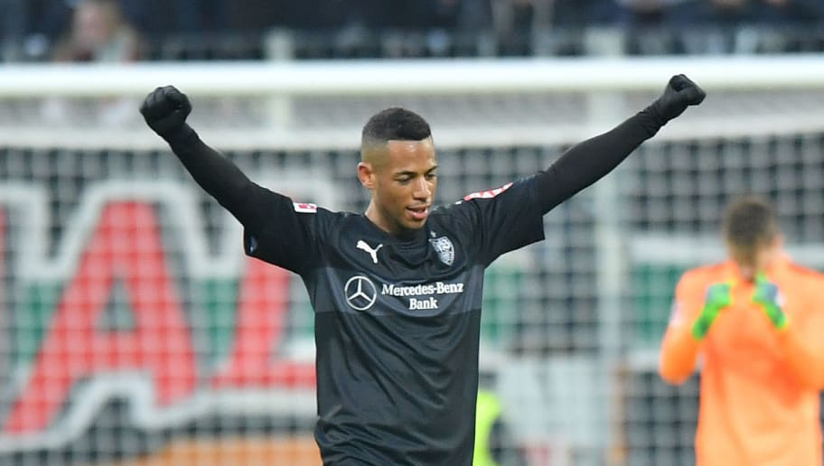AUGSBURG, GERMANY - FEBRUARY 18: Dennis Aogo of Stuttgart celebrates at the final whistle during the Bundesliga match between FC Augsburg and VfB Stuttgart at WWK-Arena on February 18, 2018 in Augsburg, Germany. (Photo by Sebastian Widmann/Bongarts/Getty Images)