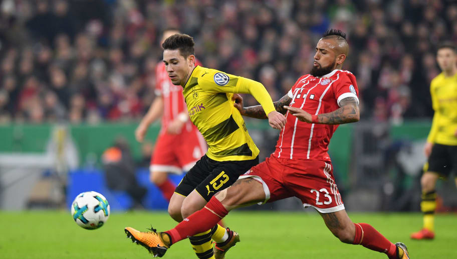 MUNICH, GERMANY - DECEMBER 20: Raphael Guerreiro of Dortmund and Arturo Vidal of Bayern Muenchen compete for the ball during the DFB Cup match between Bayern Muenchen and Borussia Dortmund at Allianz Arena on December 20, 2017 in Munich, Germany. (Photo by Sebastian Widmann/Bongarts/Getty Images)