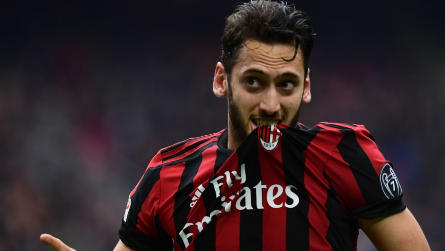 AC Milan's German midfielder Hakan Calhanoglu celebrates after scoring during the Italian Serie A football match AC Milan vs AC Chievo at the San Siro stadium in Milan on March 18, 2018. / AFP PHOTO / MIGUEL MEDINA        (Photo credit should read MIGUEL MEDINA/AFP/Getty Images)
