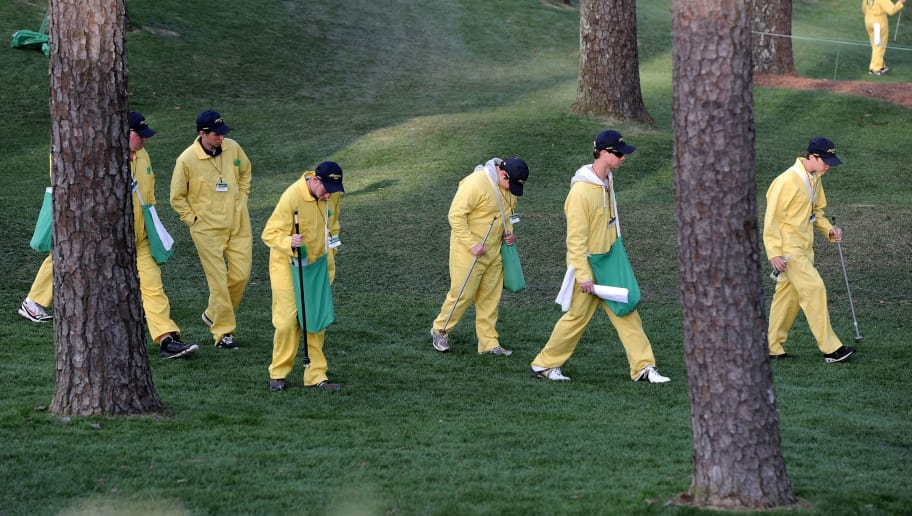 AUGUSTA, GA - APRIL 06:  Members of the litter crew clean the course after the Par 3 Contest prior to the 2011 Masters Tournament at Augusta National Golf Club on April 6, 2011 in Augusta, Georgia.  (Photo by Harry How/Getty Images)