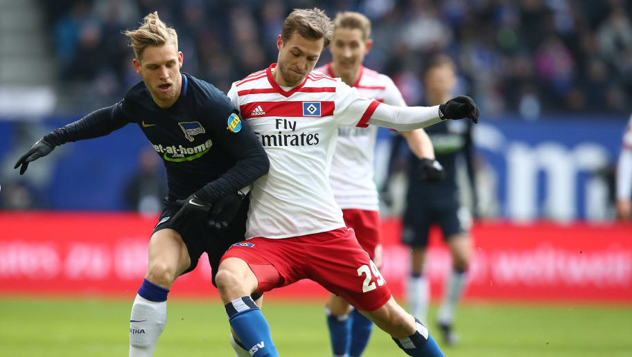 HAMBURG, GERMANY - MARCH 17:  Matti Ville Steinmann (R) of Hamburg and Arne Maier (L) of Berlin compete for the ball during the Bundesliga match between Hamburger SV and Hertha BSC at Volksparkstadion on March 17, 2018 in Hamburg, Germany.  (Photo by Oliver Hardt/Bongarts/Getty Images)