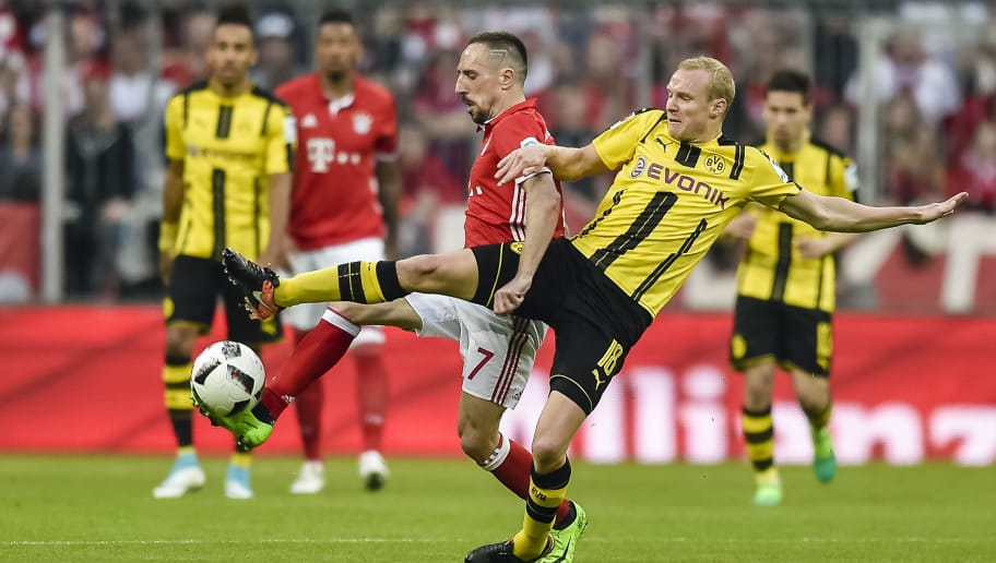 Bayern Munich's French midfielder Franck Ribery and Dortmund's midfielder Sebastian Rode vie during the German first division Bundesliga football match FC Bayern Munich v BVB Borussia Dortmund in Munich, southern Germany, on April 8, 2017. / AFP PHOTO / Guenter SCHIFFMANN / RESTRICTIONS: DURING MATCH TIME: DFL RULES TO LIMIT THE ONLINE USAGE TO 15 PICTURES PER MATCH AND FORBID IMAGE SEQUENCES TO SIMULATE VIDEO. == RESTRICTED TO EDITORIAL USE == FOR FURTHER QUERIES PLEASE CONTACT DFL DIRECTLY AT + 49 69 650050         (Photo credit should read GUENTER SCHIFFMANN/AFP/Getty Images)