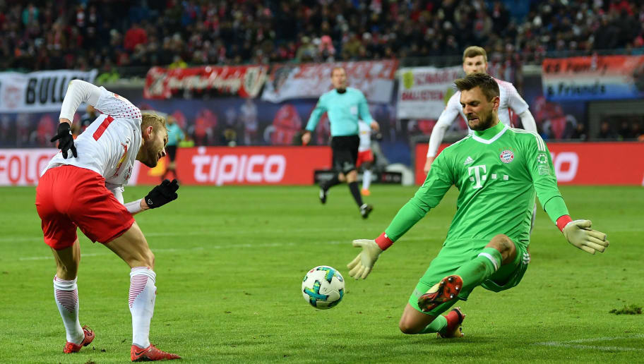 LEIPZIG, GERMANY - MARCH 18:  Sven Ulreich of Bayern isaves a shot by Konrad Laimer of Leipzig during the Bundesliga match between RB Leipzig and FC Bayern Muenchen at Red Bull Arena on March 18, 2018 in Leipzig, Germany.  (Photo by Stuart Franklin/Bongarts/Getty Images)