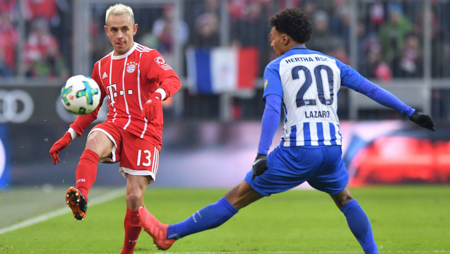 MUNICH, GERMANY - FEBRUARY 24: Rafinha of Bayern Muenchen passes the ball during the Bundesliga match between FC Bayern Muenchen and Hertha BSC at Allianz Arena on February 24, 2018 in Munich, Germany. (Photo by Sebastian Widmann/Bongarts/Getty Images)