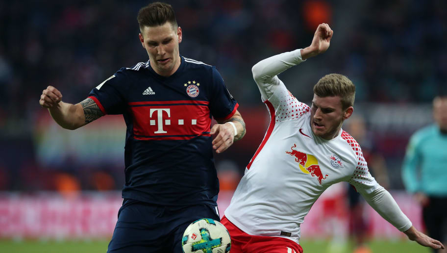 LEIPZIG, GERMANY - MARCH 18: Timo Werner (R) of RB Leipzig vies with Niklas Suele (L) of FC Bayern Muenchen during the Bundesliga match between RB Leipzig and FC Bayern Muenchen at Red Bull Arena on March 18, 2018 in Leipzig, Germany. (Photo by Ronny Hartmann/Bongarts/Getty Images)