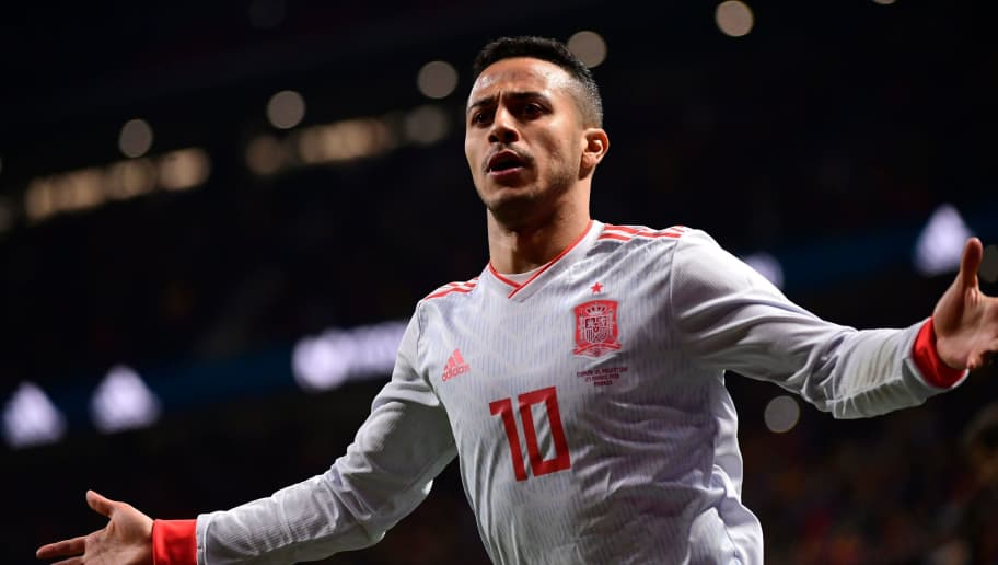 Spain's midfielder Thiago celebrates after scoring his team's fourth goal during a friendly football match between Spain and Argentina at the Wanda Metropolitano Stadium in Madrid on March 27, 2018. / AFP PHOTO / PIERRE-PHILIPPE MARCOU        (Photo credit should read PIERRE-PHILIPPE MARCOU/AFP/Getty Images)