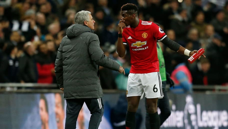 Manchester United's Portuguese manager Jose Mourinho (L) talks with Manchester United's French midfielder Paul Pogba (R) after the second Tottenham goal goes in during the English Premier League football match between Tottenham Hotspur and Manchester United at Wembley Stadium in London, on January 31, 2018. / AFP PHOTO / IKIMAGES / Ian KINGTON / RESTRICTED TO EDITORIAL USE. No use with unauthorized audio, video, data, fixture lists, club/league logos or 'live' services. Online in-match use limited to 45 images, no video emulation. No use in betting, games or single club/league/player publications.  /         (Photo credit should read IAN KINGTON/AFP/Getty Images)