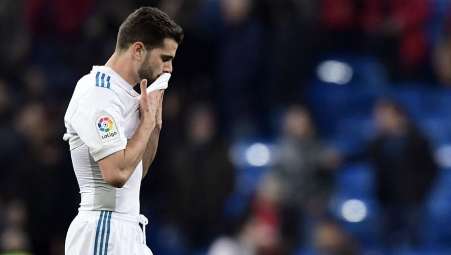 Real Madrid's Spanish defender Nacho Fernandez wipes his face at the end of the Spanish 'Copa del Rey' (King's cup) quarter-final second leg football match between Real Madrid CF and CD Leganes at the Santiago Bernabeu stadium in Madrid on January 24, 2018.  / AFP PHOTO / JAVIER SORIANO        (Photo credit should read JAVIER SORIANO/AFP/Getty Images)