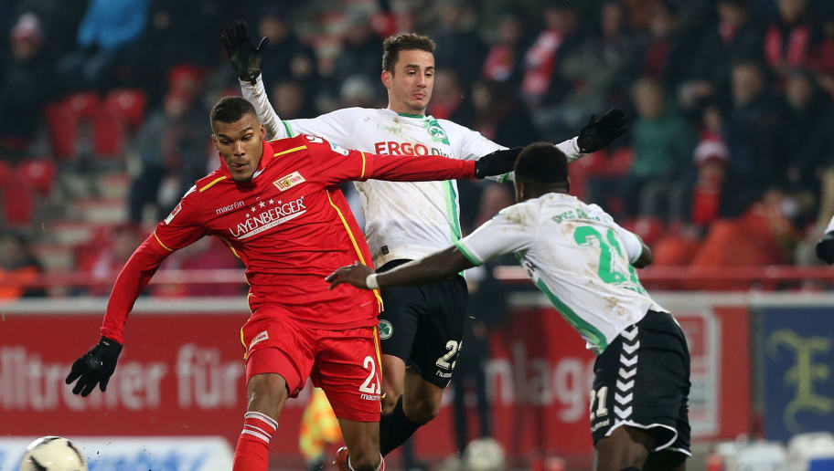 BERLIN, GERMANY - DECEMBER 16:  Collin Quaner, Sercan Sararer and Khaled Narey (L-R) battle for the ball during the Second Bundesliga match between 1. FC Union Berlin and SpVgg Greuther Fuerth at Stadion An der Alten Foersterei on December 16, 2016 in Berlin, Germany.  (Photo by Matthias Kern/Bongarts/Getty Images)