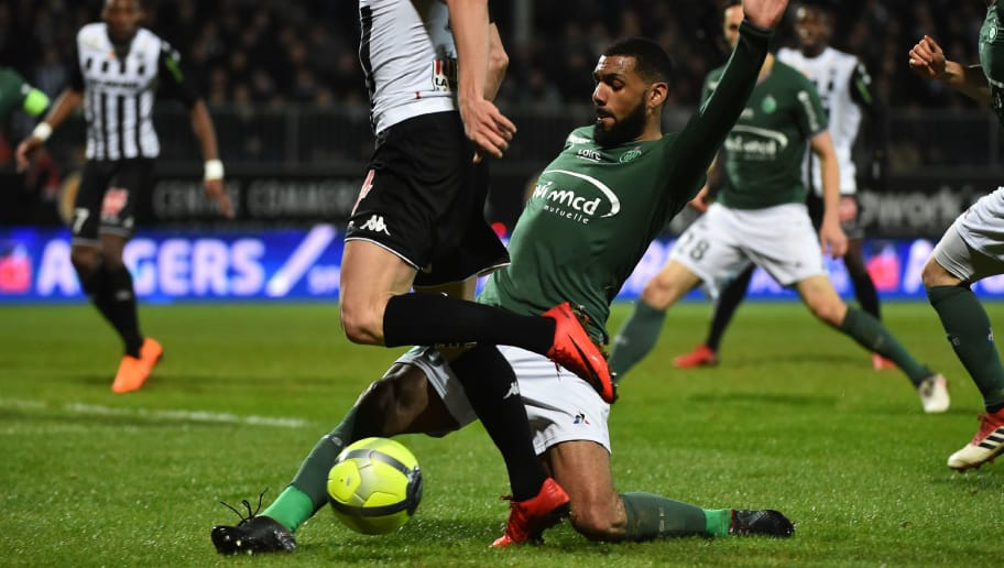 Angers' French midfielder Flavien Tait (M) vies with Saint-Etienne's French midfielder Yann Mvila (R) during the French L1 football match between Angers (SCO) and Saint-Etienne (ASSE), on February 17, 2018, at Raymond-Kopa Stadium, in Angers, northwestern France.  / AFP PHOTO / JEAN-FRANCOIS MONIER        (Photo credit should read JEAN-FRANCOIS MONIER/AFP/Getty Images)