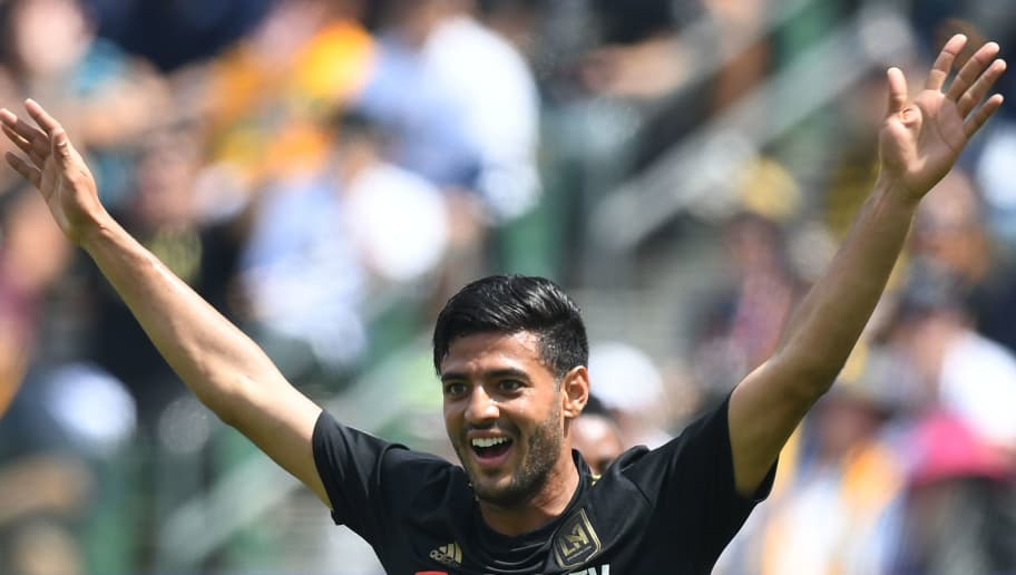 Carlos Vela of LAFC celebrates after scoring against LA Galaxy during their Major League Soccer (MLS) game at the StarHub Center in Los Angeles, California, on March 31, 2018. LA Galaxy went on to win 4-3 with two goals from Ibrahimovic.    / AFP PHOTO / Mark RALSTON        (Photo credit should read MARK RALSTON/AFP/Getty Images)