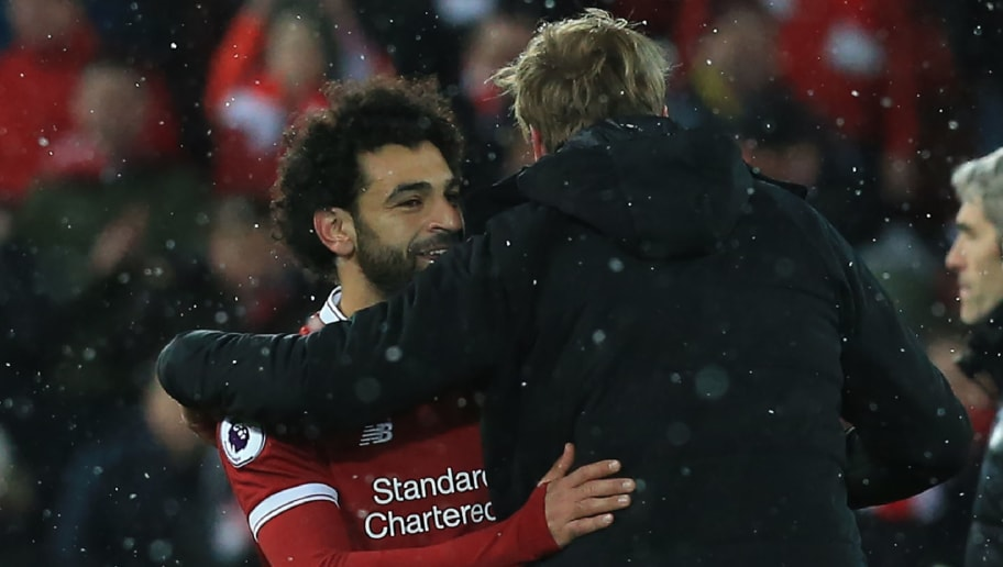 Liverpool's Egyptian midfielder Mohamed Salah gestures with Liverpool's German manager Jurgen Klopp after  the English Premier League football match between Liverpool and Watford at Anfield in Liverpool, north west England on March 17, 2018. / AFP PHOTO / Lindsey PARNABY / RESTRICTED TO EDITORIAL USE. No use with unauthorized audio, video, data, fixture lists, club/league logos or 'live' services. Online in-match use limited to 75 images, no video emulation. No use in betting, games or single club/league/player publications.  /         (Photo credit should read LINDSEY PARNABY/AFP/Getty Images)
