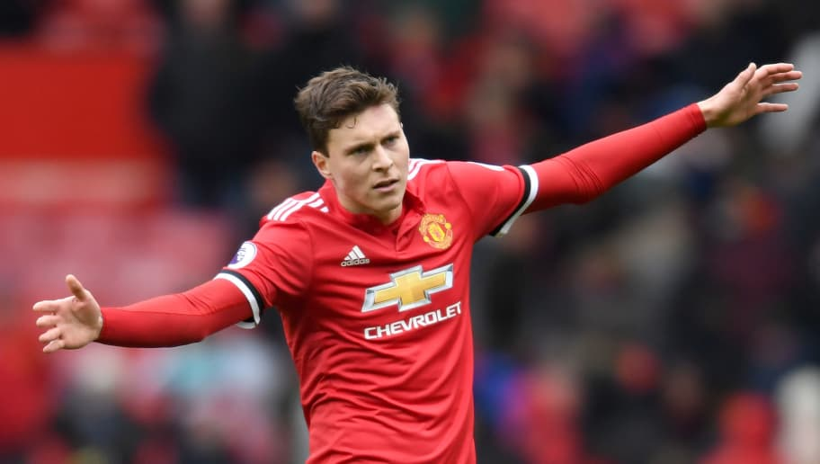 MANCHESTER, ENGLAND - MARCH 31:  Victor Lindelof of Manchester United celebrates after the Premier League match between Manchester United and Swansea City at Old Trafford on March 31, 2018 in Manchester, England.  (Photo by Ross Kinnaird/Getty Images)