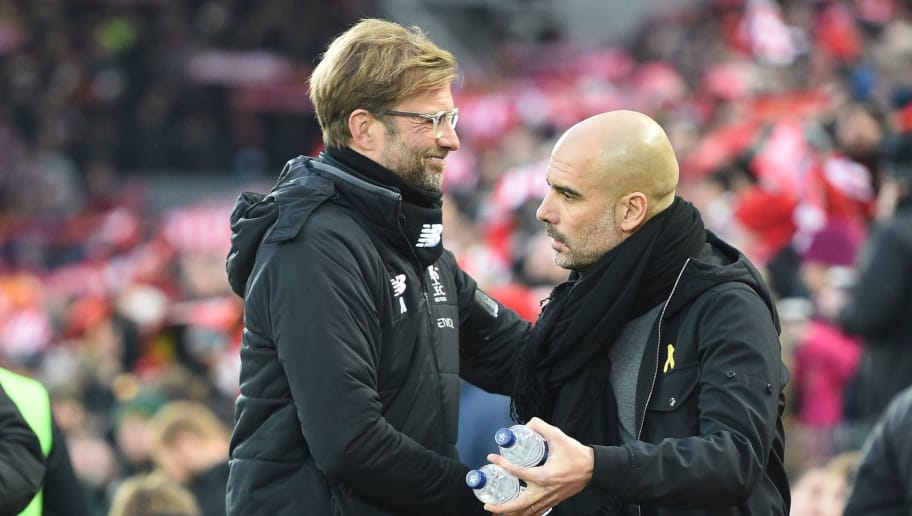 Liverpool's German manager Jurgen Klopp (L) greets Manchester City's Spanish manager Pep Guardiola (R) before kick off of  the English Premier League football match between Liverpool and Manchester City at Anfield in Liverpool, north west England on January 14, 2018. / AFP PHOTO / Oli SCARFF / RESTRICTED TO EDITORIAL USE. No use with unauthorized audio, video, data, fixture lists, club/league logos or 'live' services. Online in-match use limited to 75 images, no video emulation. No use in betting, games or single club/league/player publications.  /         (Photo credit should read OLI SCARFF/AFP/Getty Images)