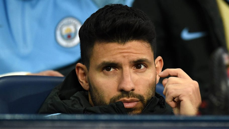 Manchester City's Argentinian striker Sergio Aguero takes his seat on the bench ahead of the UEFA Champions League round of sixteen second leg football match between Manchester City and Basel at the Etihad Stadium in Manchester, north west England, on March 7, 2018. / AFP PHOTO / Oli SCARFF        (Photo credit should read OLI SCARFF/AFP/Getty Images)