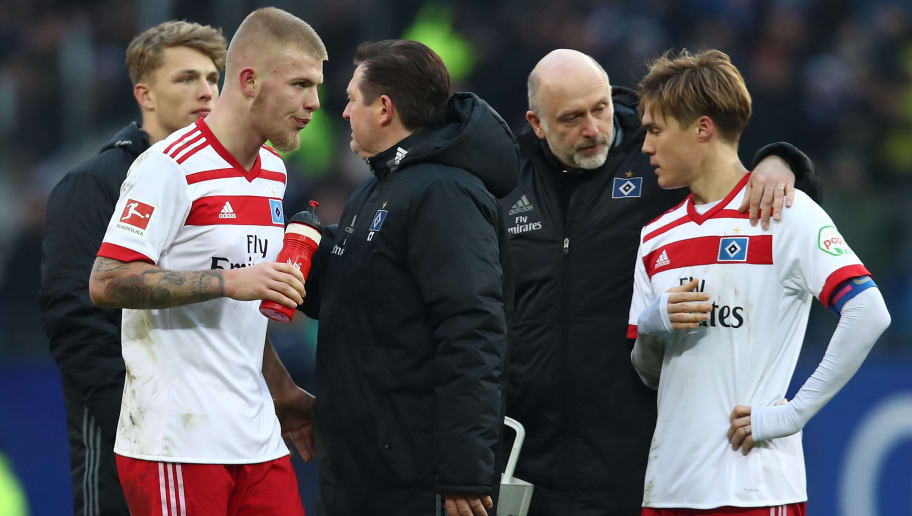 HAMBURG, GERMANY - MARCH 17: (L-R) Rick van Drongelen and Gotoku Sakai of Hamburg appears frustrated after the Bundesliga match between Hamburger SV and Hertha BSC at Volksparkstadion on March 17, 2018 in Hamburg, Germany.  (Photo by Oliver Hardt/Bongarts/Getty Images)