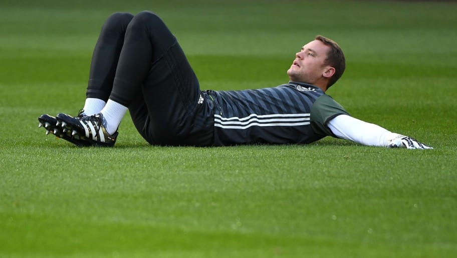 Germany's goalkeeper Manuel Neuer warms up during a training session in Hanover, Germany on October 10, 2016 on the eve of the WC 2018 football qualification match between Germany and Nothern Ireland. / AFP / PATRIK STOLLARZ        (Photo credit should read PATRIK STOLLARZ/AFP/Getty Images)