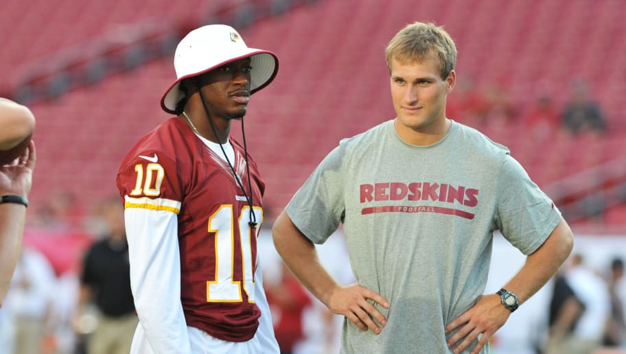 TAMPA, FL -  AUGUST 29:  Quarterbacks Robert Griffin III and Kirk Cousins #12 of the Washington Redskins  watch warmups before play against the Tampa Bay Buccaneers August 29, 2013 at Raymond James Stadium in Tampa, Florida. (Photo by Al Messerschmidt/Getty Images)