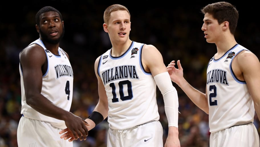 SAN ANTONIO, TX - APRIL 02: Donte DiVincenzo #10 of the Villanova Wildcats reacts with teammates in the second half against the Michigan Wolverines during the 2018 NCAA Men's Final Four National Championship game at the Alamodome on April 2, 2018 in San Antonio, Texas.  (Photo by Ronald Martinez/Getty Images)