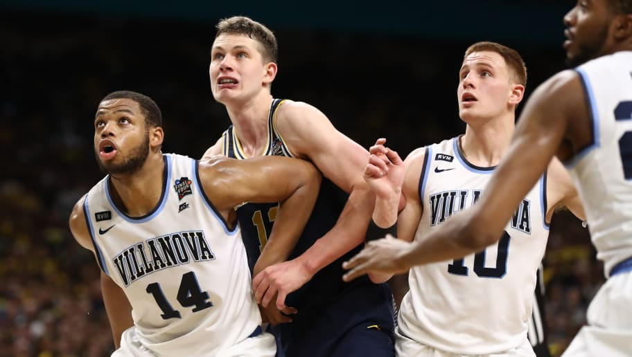 SAN ANTONIO, TX - APRIL 02:  Moritz Wagner #13 of the Michigan Wolverines battles for position against Omari Spellman #14 and Donte DiVincenzo #10 of the Villanova Wildcats in the second half during the 2018 NCAA Men's Final Four National Championship game at the Alamodome on April 2, 2018 in San Antonio, Texas.  (Photo by Ronald Martinez/Getty Images)