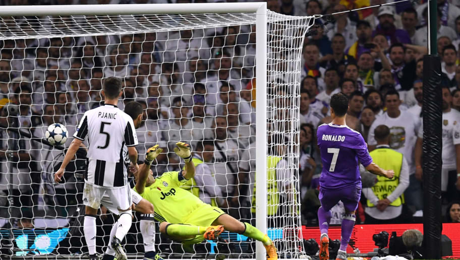 CARDIFF, WALES - JUNE 03:  Cristiano Ronaldo of Real Madrid scores his sides third goal past Gianluigi Buffon of Juventus during the UEFA Champions League Final between Juventus and Real Madrid at National Stadium of Wales on June 3, 2017 in Cardiff, Wales.  (Photo by David Ramos/Getty Images)