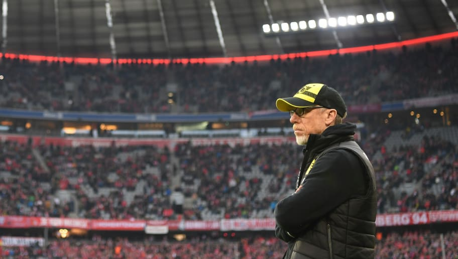 MUNICH, GERMANY - MARCH 31:  (EDITORS NOTE; This image was processed using digital filters.)Peter Stoeger, head coach of Dortmund looks on during the Bundesliga match between FC Bayern Muenchen and Borussia Dortmund at Allianz Arena on March 31, 2018 in Munich, Germany.  (Photo by Stuart Franklin/Bongarts/Getty Images)