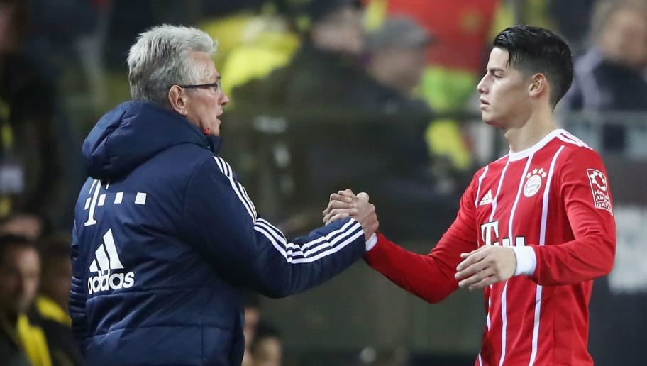 DORTMUND, GERMANY - NOVEMBER 04: James Rodriguez of Muenchen shakes hands with head coach Jupp Heynckes after being substituted during the Bundesliga match between Borussia Dortmund and FC Bayern Muenchen at Signal Iduna Park on November 4, 2017 in Dortmund, Germany.  (Photo by Alex Grimm/Bongarts/Getty Images)