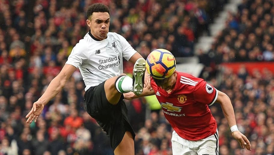 TOPSHOT - Liverpool's English midfielder Trent Alexander-Arnold (L) concedes a free kick as he challenges Manchester United's Chilean striker Alexis Sanchez (R) for the ball during the English Premier League football match between Manchester United and Liverpool at Old Trafford in Manchester, north west England, on March 10, 2018. / AFP PHOTO / Oli SCARFF / RESTRICTED TO EDITORIAL USE. No use with unauthorized audio, video, data, fixture lists, club/league logos or 'live' services. Online in-match use limited to 75 images, no video emulation. No use in betting, games or single club/league/player publications.  /         (Photo credit should read OLI SCARFF/AFP/Getty Images)