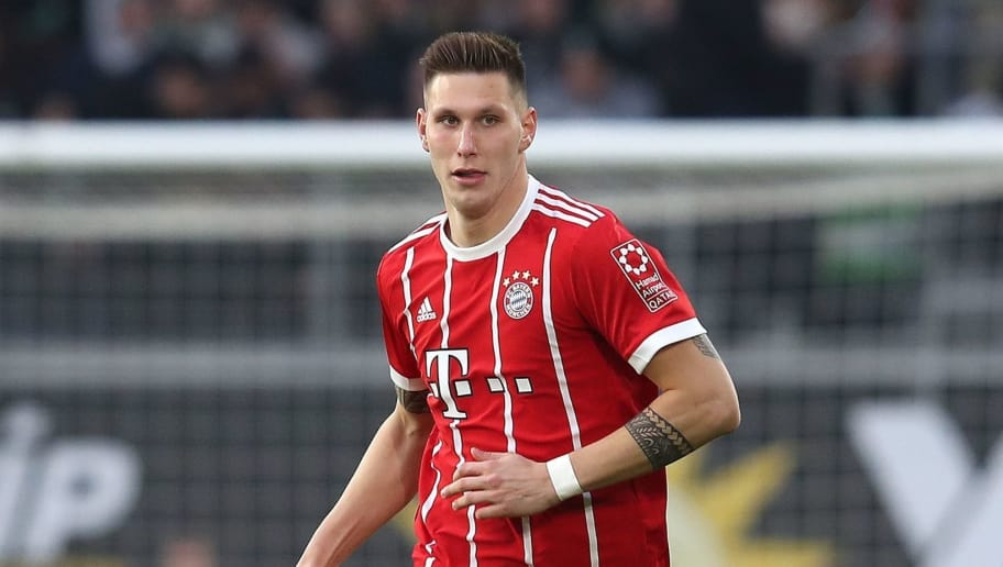 Bayern Munich's German defender Niklas Suele runs with the ball during the German first division Bundesliga football match VfL Wolfsburg vs FC Bayern Munich at Volkswagen Arena on February 17, 2018 in Wolfsburg, Germany. / AFP PHOTO / Ronny Hartmann / RESTRICTIONS: DURING MATCH TIME: DFL RULES TO LIMIT THE ONLINE USAGE TO 15 PICTURES PER MATCH AND FORBID IMAGE SEQUENCES TO SIMULATE VIDEO. == RESTRICTED TO EDITORIAL USE == FOR FURTHER QUERIES PLEASE CONTACT DFL DIRECTLY AT + 49 69 650050         (Photo credit should read RONNY HARTMANN/AFP/Getty Images)