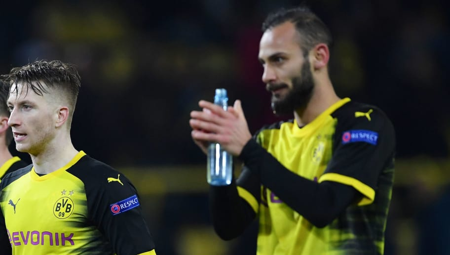 DORTMUND, GERMANY - MARCH 08:  Christian Pulisic, Maximilian Philipp, Marco Reus and Omer Toprak of Borussia Dortmund look dejected in defeat after the UEFA Europa League Round of 16 match between Borussia Dortmund and FC Red Bull Salzburg at the Signal Iduna Park on March 8, 2018 in Dortmund, Germany.  (Photo by Stuart Franklin/Bongarts/Getty Images)