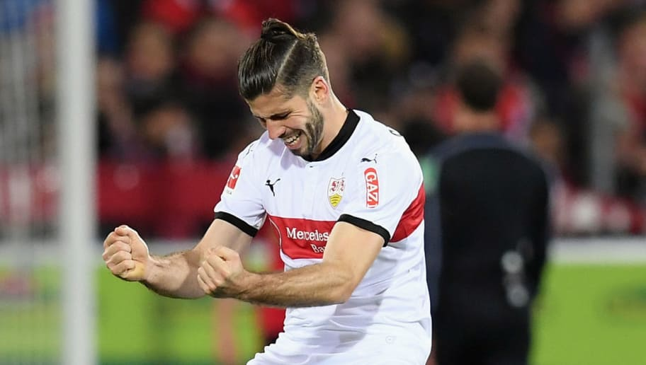 FREIBURG IM BREISGAU, GERMANY - MARCH 16: Emiliano Insua of Stuttgart celebrates after team mate Mario Gomez scored his team's second goal during the Bundesliga match between Sport-Club Freiburg and VfB Stuttgart at Schwarzwald-Stadion on March 16, 2018 in Freiburg im Breisgau, Germany.  (Photo by Matthias Hangst/Bongarts/Getty Images)