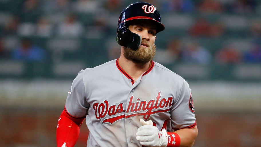 ATLANTA, GA - APRIL 02:  Bryce Harper #34 of the Washington Nationals heads to third base after hitting a three-run homer in the second inning against the Atlanta Braves at SunTrust Park on April 2, 2018 in Atlanta, Georgia.  (Photo by Kevin C. Cox/Getty Images)