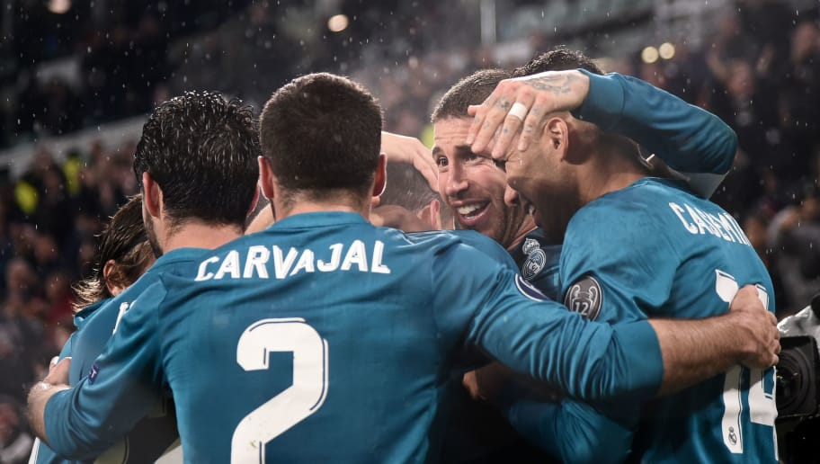Real Madrid's players celebrate their second goal during the UEFA Champions League quarter-final first leg football match between Juventus and Real Madrid at the Allianz Stadium in Turin on April 3, 2018. / AFP PHOTO / Marco BERTORELLO        (Photo credit should read MARCO BERTORELLO/AFP/Getty Images)