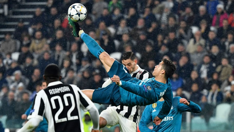 Real Madrid's Portuguese forward Cristiano Ronaldo (C) scores during the UEFA Champions League quarter-final first leg football match between Juventus and Real Madrid at the Allianz Stadium in Turin on April 3, 2018. / AFP PHOTO / Alberto PIZZOLI        (Photo credit should read ALBERTO PIZZOLI/AFP/Getty Images)