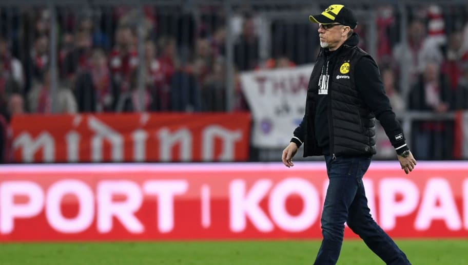 Dortmund's Austrian headcoach Peter Stoeger leaves the pitch after  the German first division Bundesliga football match FC Bayern Munich vs Borussia Dortmund in Munich, southern Germany, on March 31, 2018.  Munich won the match 6-0. / AFP PHOTO / Christof STACHE / RESTRICTIONS: DURING MATCH TIME: DFL RULES TO LIMIT THE ONLINE USAGE TO 15 PICTURES PER MATCH AND FORBID IMAGE SEQUENCES TO SIMULATE VIDEO. == RESTRICTED TO EDITORIAL USE == FOR FURTHER QUERIES PLEASE CONTACT DFL DIRECTLY AT + 49 69 650050  / RESTRICTIONS: DURING MATCH TIME: DFL RULES TO LIMIT THE ONLINE USAGE TO 15 PICTURES PER MATCH AND FORBID IMAGE SEQUENCES TO SIMULATE VIDEO. == RESTRICTED TO EDITORIAL USE == FOR FURTHER QUERIES PLEASE CONTACT DFL DIRECTLY AT + 49 69 650050        (Photo credit should read CHRISTOF STACHE/AFP/Getty Images)