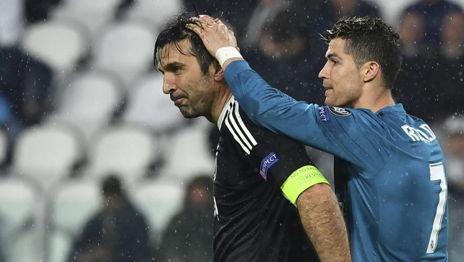 TOPSHOT - Real Madrid's Portuguese forward Cristiano Ronaldo (R) comforts Juventus' goalkeeper from Italy Gianluigi Buffon at the end of the UEFA Champions League quarter-final first leg football match between Juventus and Real Madrid at the Allianz Stadium in Turin on April 3, 2018. Ronaldo scores twice as Real Madrid beat Juventus 3-0. / AFP PHOTO / Alberto PIZZOLI        (Photo credit should read ALBERTO PIZZOLI/AFP/Getty Images)