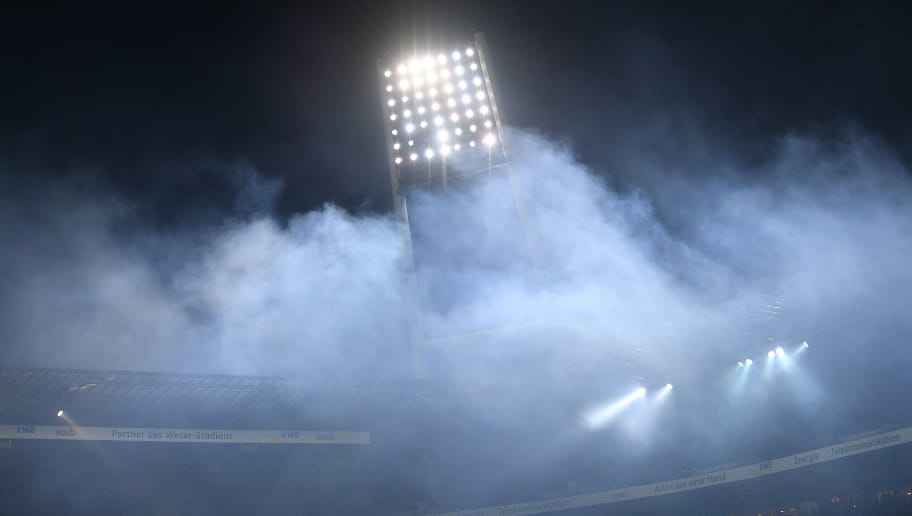 BREMEN, GERMANY - FEBRUARY 24: Smoke leaves the arena after supporter of Hamburg lit flares during the Bundesliga match between SV Werder Bremen and Hamburger SV at Weserstadion on February 24, 2018 in Bremen, Germany. (Photo by Lukas Schulze/Bongarts/Getty Images)