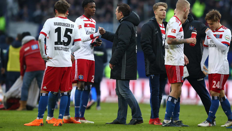 HAMBURG, GERMANY - MARCH 17: (L-R) Gideon Jung, Head coach Christian Titz,Jann Fiete Arp,Rick van Drongelen and Gotoku Sakai of Hamburg appears frustrated after the Bundesliga match between Hamburger SV and Hertha BSC at Volksparkstadion on March 17, 2018 in Hamburg, Germany.  (Photo by Oliver Hardt/Bongarts/Getty Images)