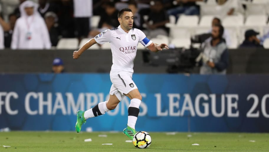 Al-Sadd's Xavier Hernandez kicks the  ball during the AFC Champions League match al-Sadd vs Persepolis at the Jassim Bin Hamad Stadium in Doha on February 20, 2018.  / AFP PHOTO / KARIM JAAFAR        (Photo credit should read KARIM JAAFAR/AFP/Getty Images)